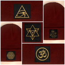 Load image into Gallery viewer, burgundy beanie w golden compass by buddha gear eye of horus merkaba mushrooms flower of life om yoga hat