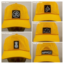 Load image into Gallery viewer, Mustard dad hat w handmade silver Ganesha symbol