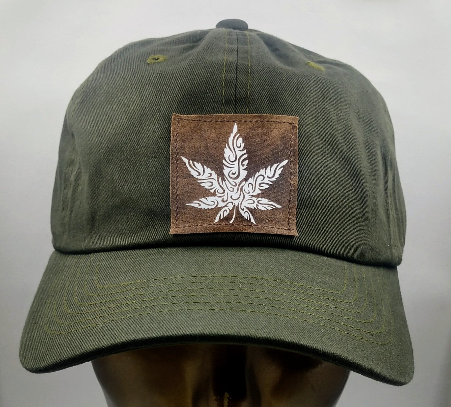 Olive dad hat with handmade cannabis patch