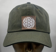 Load image into Gallery viewer, Buddha Gear Buddha Lids Buddha Wear Olive dad hat with hand made flower of life symbol   The flower of life is one of the oldest symbols known to man and is a very powerful, sacred geometry symbol and creation pattern to meditate or do yoga with, especially with a powerful crystal! Even Leonardo da Vinci studied the Flower of Life and its mathematical properties. Metatron's Cube is a symbol derived from the Flower of Lifewhich was used as a containment circle or creation circle.