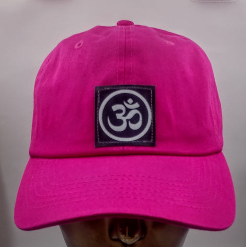 Buddha Gear Buddha lids Buddha wear Hot pink dad hat with hand made ohm symbol  Ohm is a sacred sound and a sacred spiritual symbol in Hinduism, that signifies the essence of the ultimate reality, consciousness or Atman (soul). Some believe it is the sound of creation.