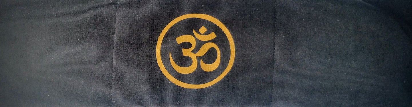 Ohm is a sacred sound and a sacred spiritual symbol in Hinduism, that signifies the essence of the ultimate reality, consciousness or Atman (soul). Some believe it is the sound of creation.  Our original Buddha Band - Yoga, meditation headband has hidden pocket to hold a crystal over your third eye while you meditate, practice yoga or sleep. By Buddha Gear
