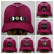 Load image into Gallery viewer, Buddha lids Buddha gear Buddha wear Buddha clothing Burgundy snapback with hand made Merkaba symbol   The word Merkaba is actually composed of three separate words: Mer, which means light, Ka, which means spirit and Ba, which means Body. Put together, these three words connote the union of spirit with the body, surrounded by light. The symbol, which takes the shape of a star, is believed to be a divine vehicle made entirely of light and designed to transport or connect the spirit and body to higher realms.