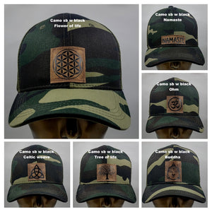 Buddha Lids Buddha Gear Buddha Wear Camo snapback with handmade ohm symbol  Ohm is a sacred sound and a sacred spiritual symbol in Hinduism, that signifies the essence of the ultimate reality, consciousness or Atman (soul). Some believe it is the sound of creation.