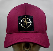 Load image into Gallery viewer, Buddha gear Buddha Lid Buddha wear Burgundy snapback with hand made compass symbol   Find your true North with your Compass Buddha Beanie! Wearing a compass over your third eye is a great that it's never too late in life to change or alter your course.  The compass points in four directions; North, South, East and West, harkening back to sailors and ships traversing the stormy seas on their way home from a long journey. The compass holds meaning for a traveler, being a symbol for guidance, the ability to po