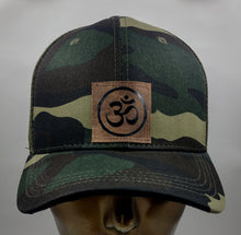 Load image into Gallery viewer, Buddha Gear Buddha Lids Buddha Wear Camo snapback with handmade ohm symbol  Ohm is a sacred sound and a sacred spiritual symbol in Hinduism, that signifies the essence of the ultimate reality, consciousness or Atman (soul). Some believe it is the sound of creation.