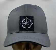 Load image into Gallery viewer, Buddha gear Buddha lids Buddha wear Burgundy snapback with hand made compass symbol   Find your true North with your Compass Buddha Beanie! Wearing a compass over your third eye is a great that it's never too late in life to change or alter your course.  The compass points in four directions; North, South, East and West, harkening back to sailors and ships traversing the stormy seas on their way home from a long journey. The compass holds meaning for a traveler, being a symbol for guidance, the ability to p