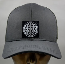Load image into Gallery viewer, Buddha gear Buddha lids Grey snapback with handmade flower of life symbol  The flower of life is one of the oldest symbols known to man and is a very powerful, sacred geometry symbol and creation pattern to meditate or do yoga with, especially with a powerful crystal! Even Leonardo da Vinci studied the Flower of Life and its mathematical properties. Metatron's Cube is a symbol derived from the Flower of Life which was used as a containment circle or creation circle.