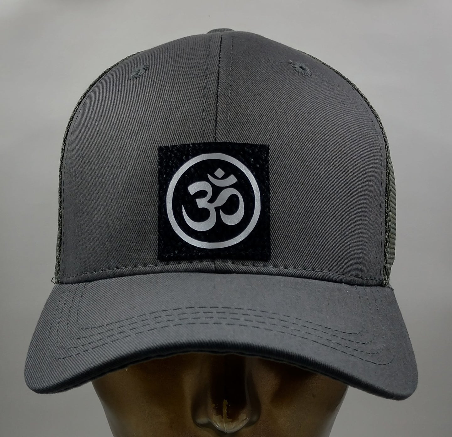Buddha gear Buddha Lids Buddha Wear Ohm is a sacred sound and a sacred spiritual symbol in Hinduism, that signifies the essence of the ultimate reality, consciousness or Atman (soul). Some believe it is the sound of creation.