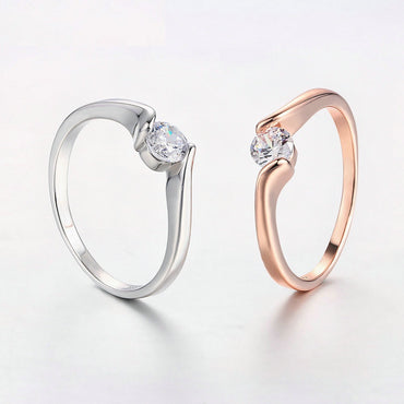 Concise 4mm Round Cut Cubic Zirconia Rose Gold Color Ring