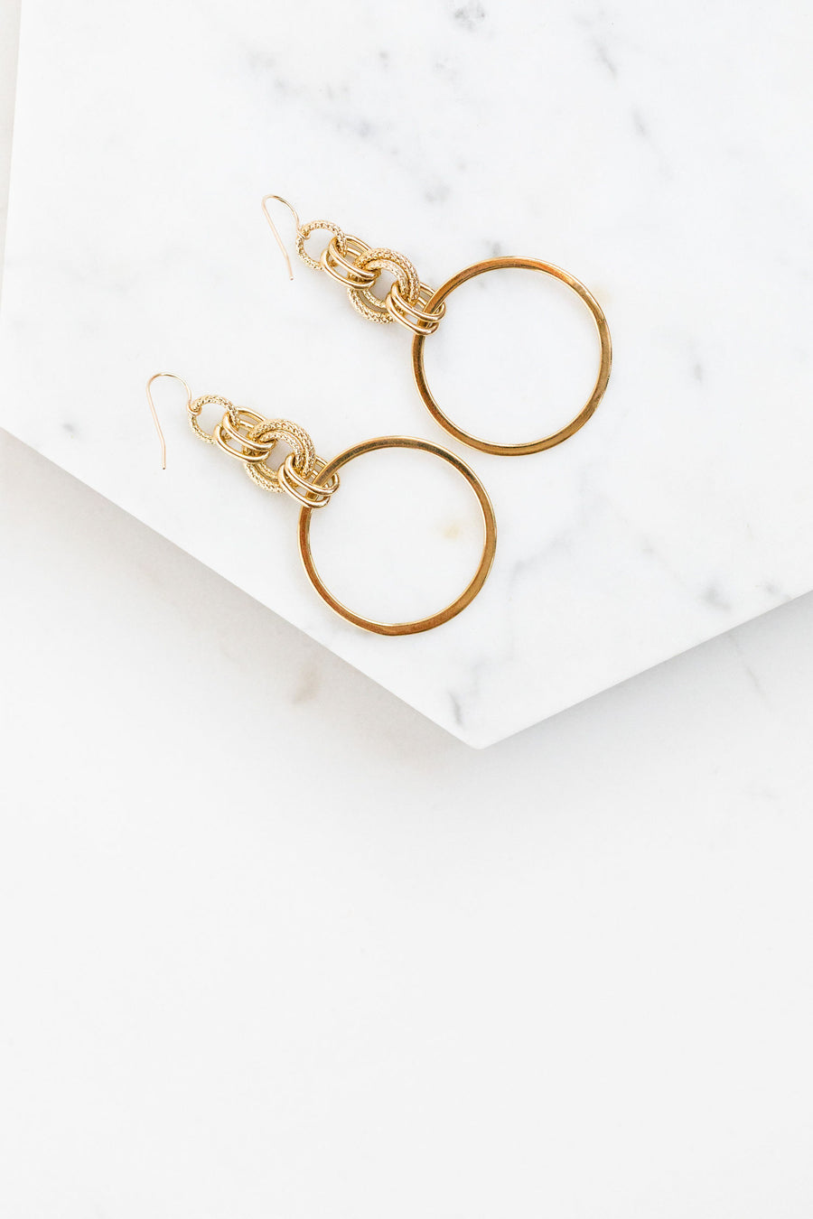 Find the perfect pair of earrings you're looking for from Charme Silkiner! These 24k gold textured chain drop earrings are seriously stunning. Perfect to dress or dress down any outfit the Dusk Earrings are the perfect must have for everyone!
