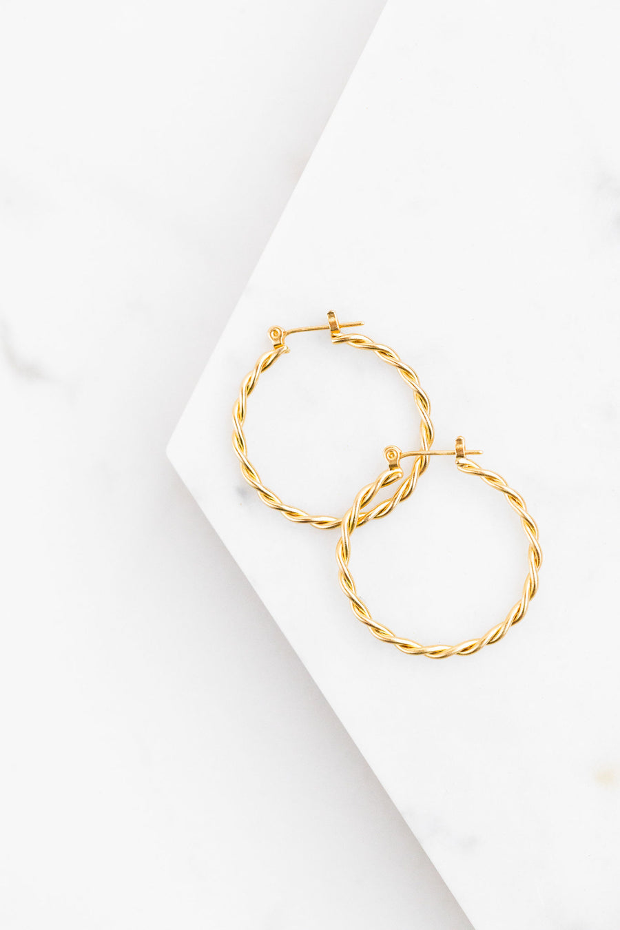 Find the perfect pair of earrings you're looking for from Charme Silkiner! These antiqued gold spiral hoop earrings are seriously stunning. Perfect to dress or dress down any outfit the Salem Earrings are the perfect must have for everyone!
