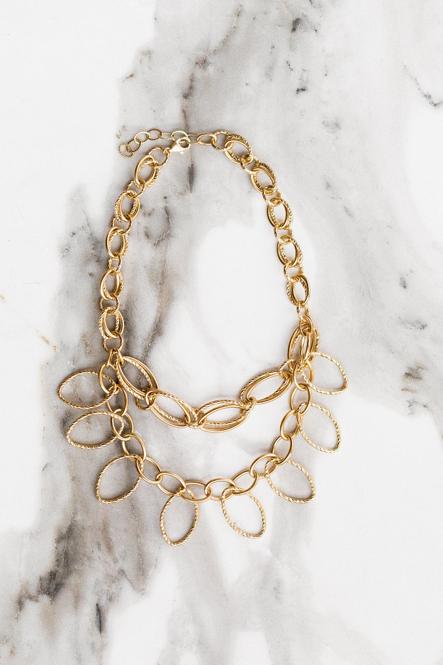 Find the perfect necklace you're looking for from Charme Silkiner! This beautiful 24K Gold + Diamond Overlay Cut Chain Necklace is seriously chic. Great for layering or wearing alone the Rianna Necklace is the perfect piece of unique jewelry that everyone should own to make a statement!