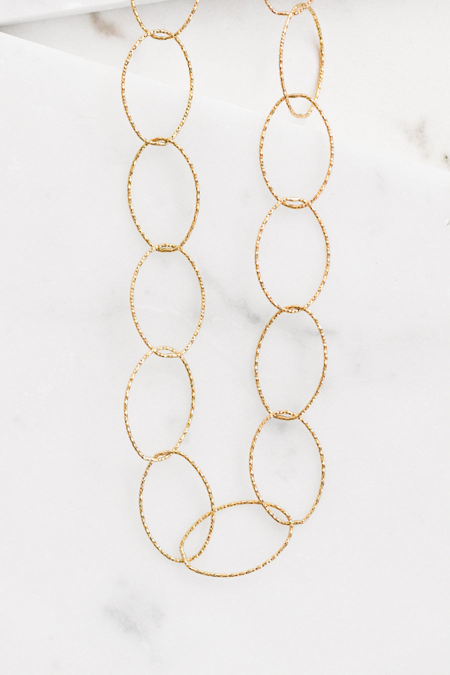 Find the perfect necklace you're looking for from Charme Silkiner! This beautiful 14K Gold Filled Diamond Cut Chain Necklace is perfection. Great for layering or wearing alone the Christa Necklace is the perfect piece of unique jewelry that everyone should own.