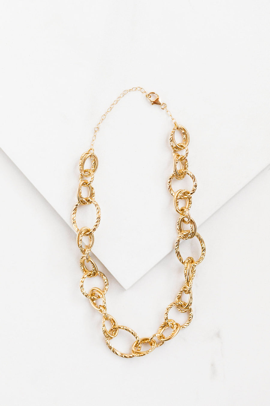 Find the perfect necklace you're looking for from Charme Silkiner! This beautiful 24k gold overlay with diamond cut chain necklace is simple yet perfect. Great for layering or wearing alone the Guiliana Necklace is the perfect piece of unique jewelry that everyone should own.