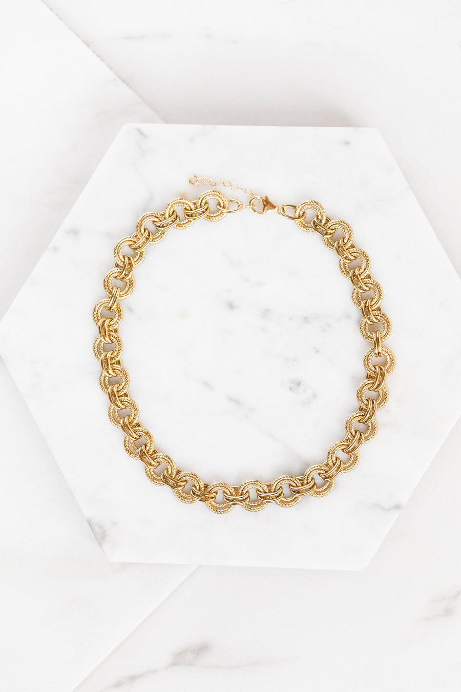 Find the perfect necklace you're looking for from Charme Silkiner! This beautiful chunky 14K Gold Overlay Necklace with amazing textured detail is pure perfection. Great for layering or wearing alone the Blaine Necklace is the perfect piece of unique jewelry that everyone should own.