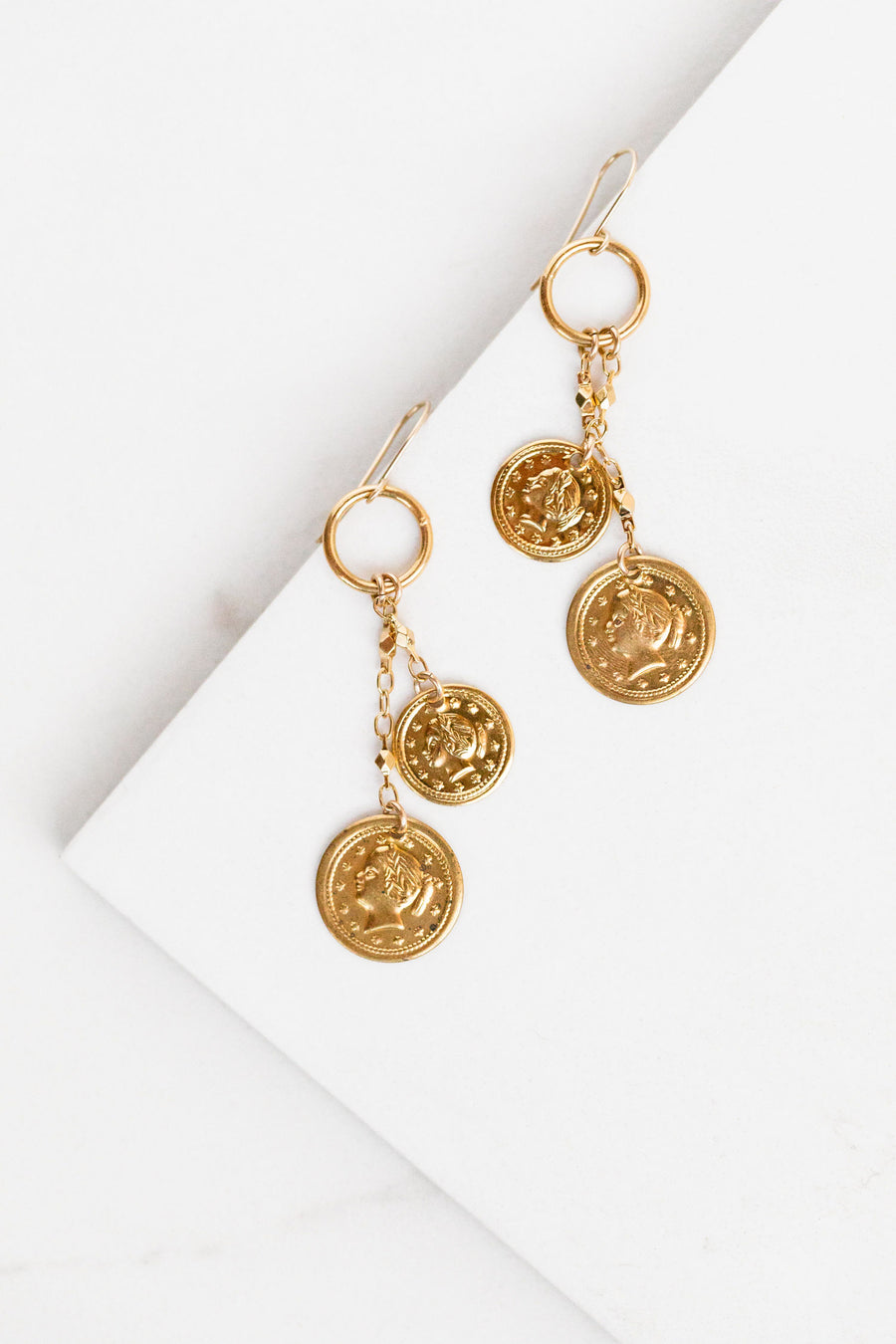 Find the perfect pair of earrings you're looking for from Charme Silkiner! These 14k Gold Hoop Earrings with Gold Coin Accents are seriously stunning. Perfect to dress or dress down any outfit the Chiraz Earrings are the perfect must have for everyone!
