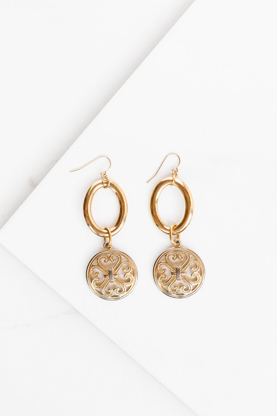 Find the perfect pair of earrings you're looking for from Charme Silkiner! These 24k gold overlay hoop earrings with a gold medallion coin are seriously stunning. Perfect to dress or dress down any outfit the Gianna Earrings are the perfect must have for everyone!