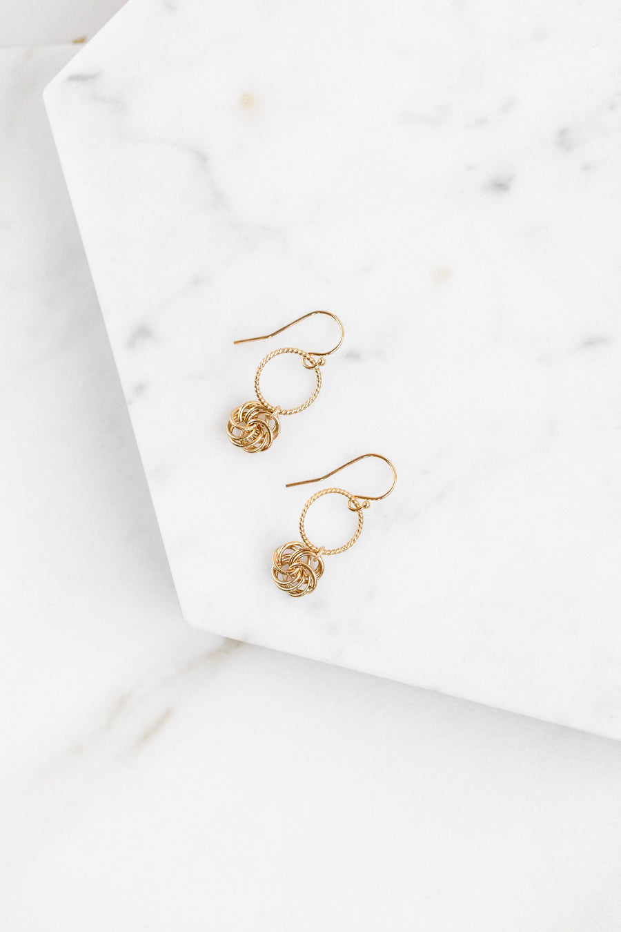 Find the perfect pair of earrings you're looking for from Charme Silkiner! These 14k gold hoop earring with a flower detail charm is seriously stunning. Perfect to dress or dress down any outfit the Malina Earrings are the perfect must have for everyone!