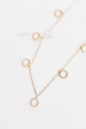Find the perfect necklace you're looking for from Charme Silkiner! This beautiful 14K Gold Chain Necklace with Halo CZ accents is sheer perfection. Great for layering or wearing alone the Awake Necklace is the perfect piece of unique jewelry that everyone should own.