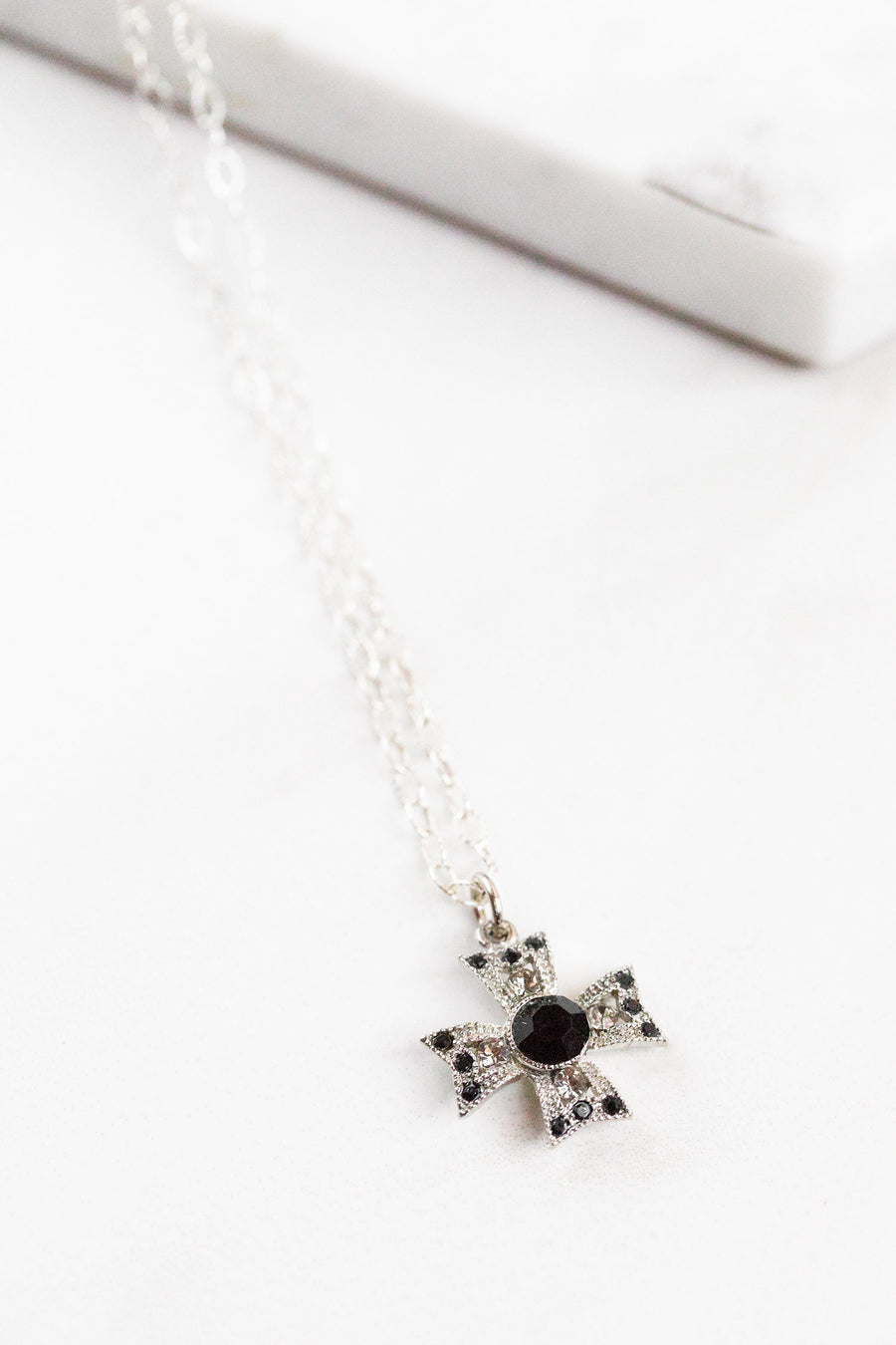 Find the perfect necklace you're looking for from Charme Silkiner! This beautiful Sterling Silver Chain Necklace with Black Swarovski Cross is perfection. Great for layering or wearing alone the Grea Necklace is the perfect piece of unique jewelry that everyone should own.
