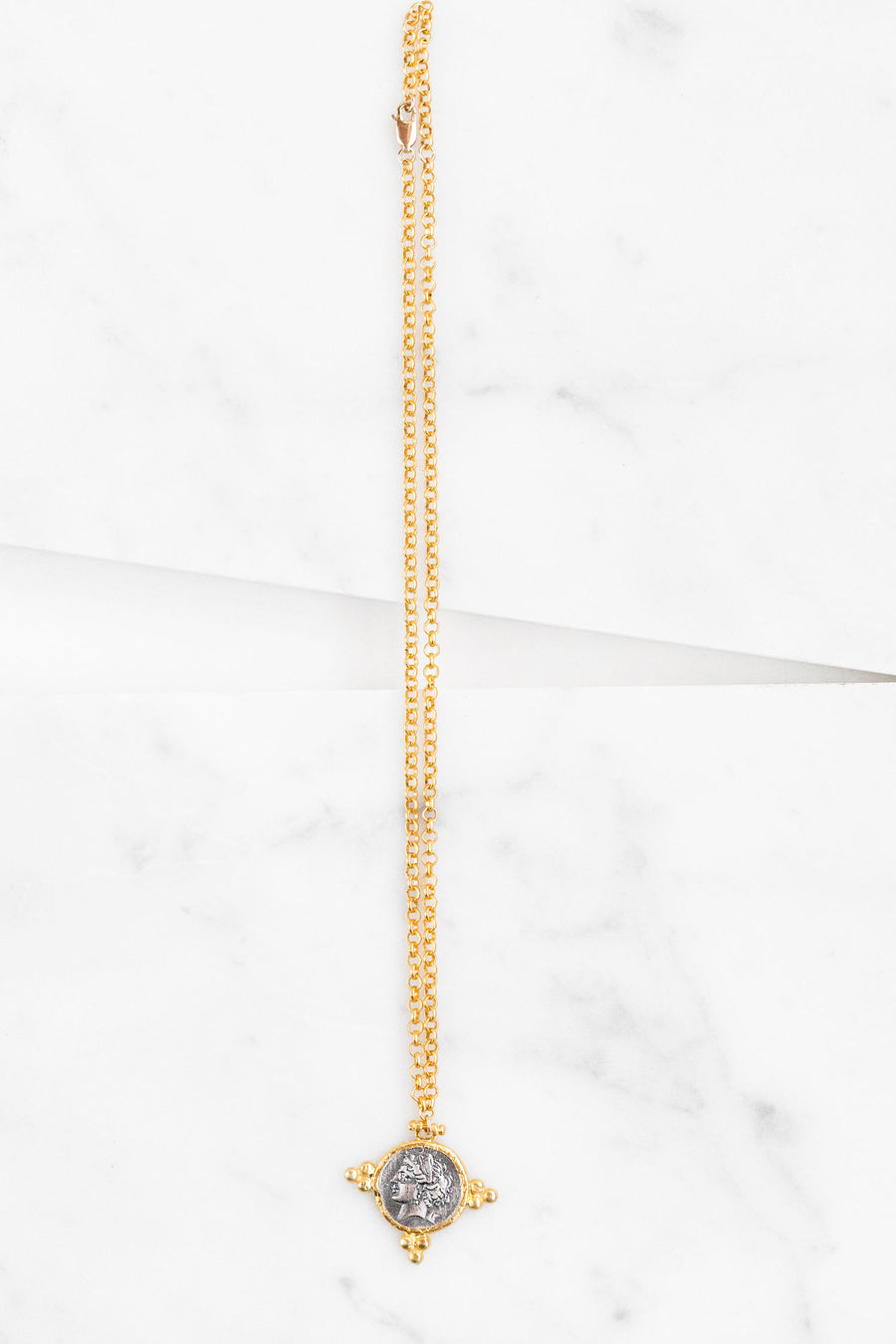 Find the perfect necklace you're looking for from Charme Silkiner! This beautiful 14K Gold Chain Necklace with a replica Roman medallion is perfection. Great for layering or wearing alone the Dior Necklace is the perfect piece of unique jewelry that everyone should own.