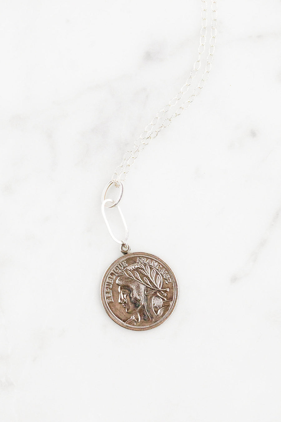 Find the perfect necklace you're looking for from Charme Silkiner! This gorgeous sterling silver necklace with a vintage French medallion is sheer perfection.  Great for layering or wearing alone the Galen Necklace is the perfect piece of unique jewelry that everyone should own.