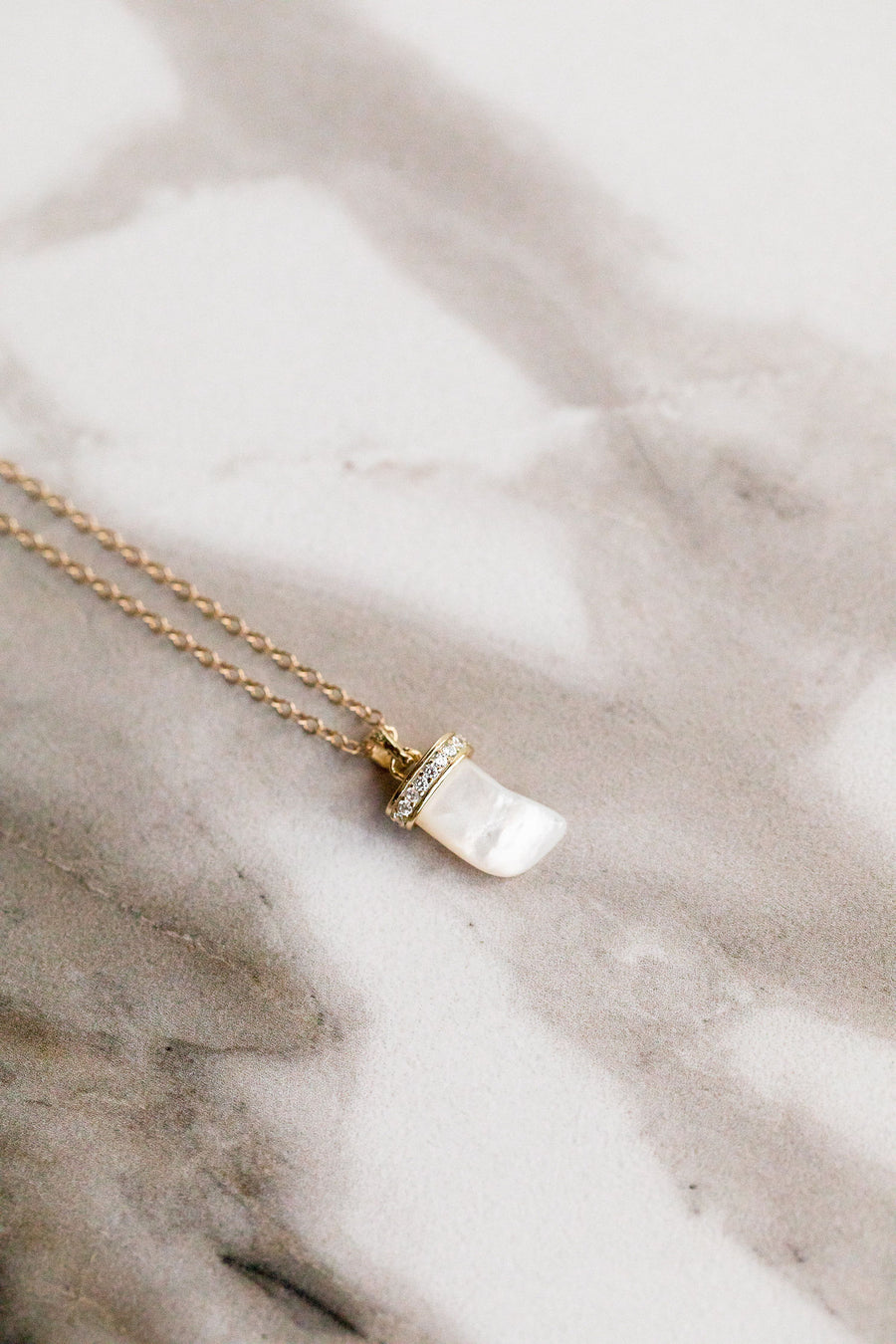 Find the perfect necklace you're looking for from Charme Silkiner! This beautiful 14K Gold Chain Necklace with Mother of Pearl Horn and CZ Accents is pure perfection. Great for layering or wearing alone the Haze Necklace is the perfect piece of unique jewelry that everyone should own.