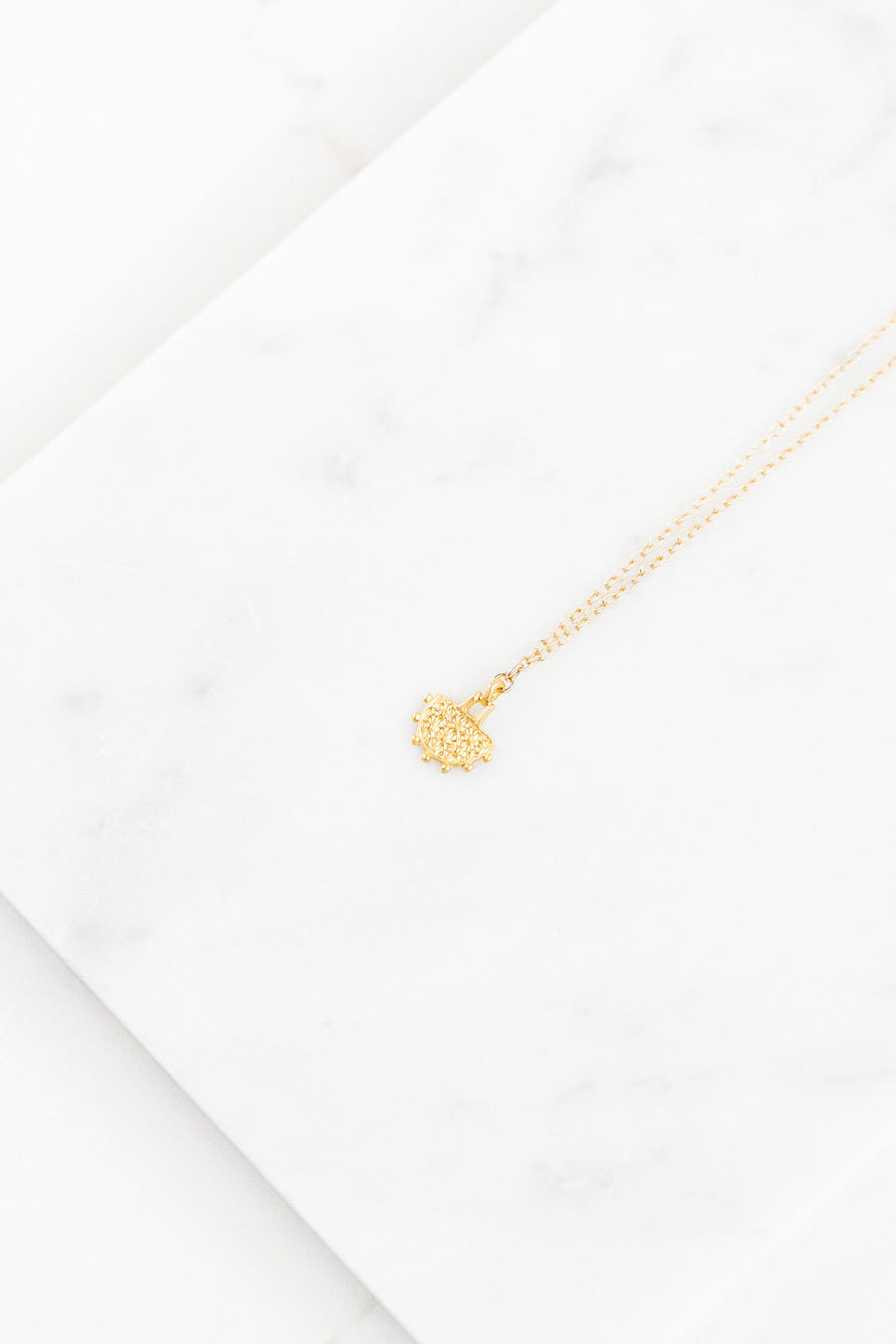 Find the perfect necklace you're looking for from Charme Silkiner! This beautiful 14K Gold Chain Necklace with a Tribal Pendant is perfection. Great for layering or wearing alone the Milo Necklace is the perfect piece of unique jewelry that everyone should own.