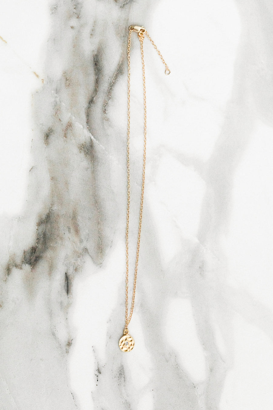 Find the perfect necklace you're looking for from Charme Silkiner! This beautiful 14K Gold Filled Chain Necklace with a hammered disc and delicate crystals is perfection. Great for layering or wearing alone the Tawney Necklace is the perfect piece of unique jewelry that everyone should own.