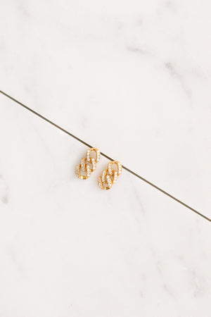Find the perfect pair of earrings you're looking for from Charme Silkiner! These 14k gold + CZ pave chain earrings are seriously stunning. Perfect to dress or dress down any outfit the Nest Earrings are the perfect must have for everyone!