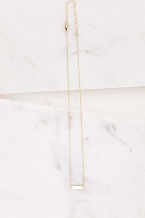 Find the perfect necklace you're looking for from Charme Silkiner! This beautiful 14K Gold Plated Necklace with a cz detailed gold bar is pure perfection. Great for layering or wearing alone the Ima Necklace is the perfect piece of unique jewelry that everyone should own.
