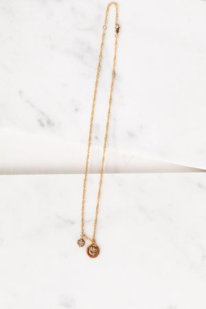 Find the perfect necklace you're looking for from Charme Silkiner! This beautiful 22k Gold Chain Necklace with cz accents and rose gold charm is seriously perfection. Great for layering or wearing alone the Reva Necklace is the perfect piece of unique jewelry that everyone should own.