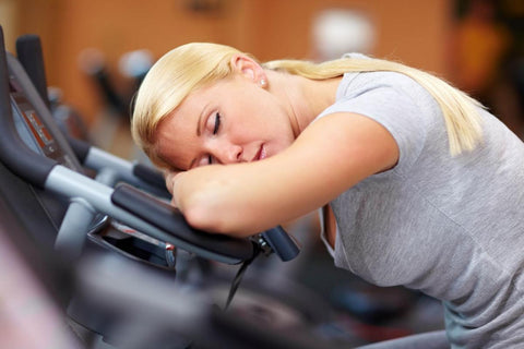 Exercise boredom - woman sleeping at the gym