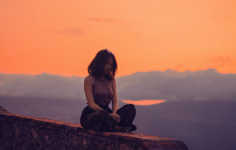 Woman sitting at twilight