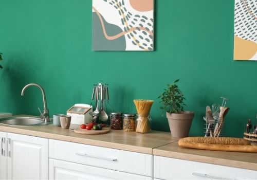 Kitchen area painted with a bright green/blue paint color.