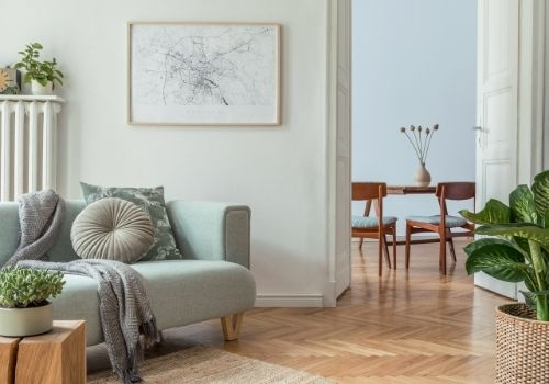 Interior home living room painted in a light & airy pastel green tone. A portrait of  paint colours from the 2021 Trends collection used in the interior of a home.