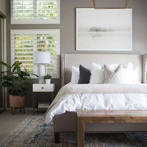 A bedroom painted with Benjamin Moore Graystone, paint color available at Clement's Paint in Austin, Texas.