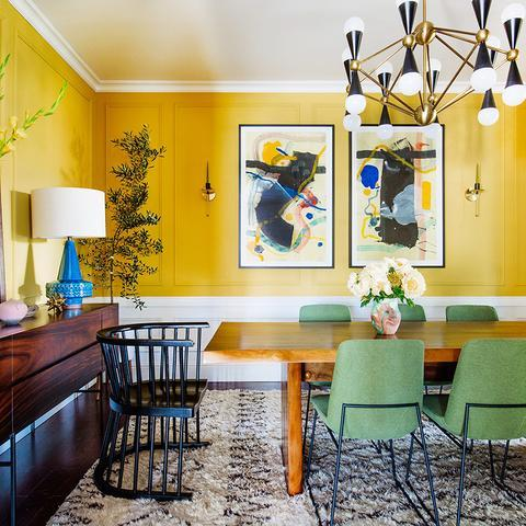 A dining room with half of the wall painted with Benjamin Moore's Yolk, paint color available at Clement's Paint in Austin, Texas.