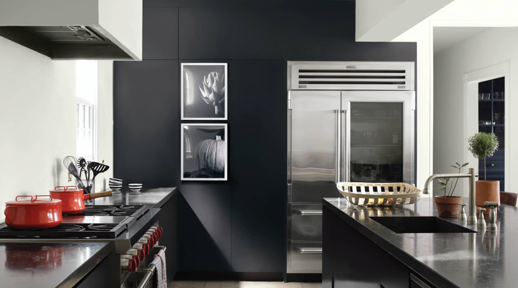 A kitchen painted with Benjamin Moore's 2126-10 Black Tar paint color, available at Clement's Paint in Austin, TX.