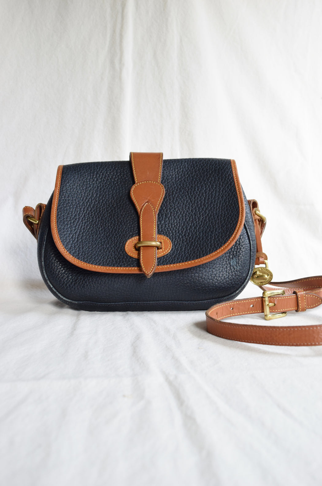 Vintage Dooney & Bourke Crossbody Saddle Bag in Navy and British Tan | All Weather Leather