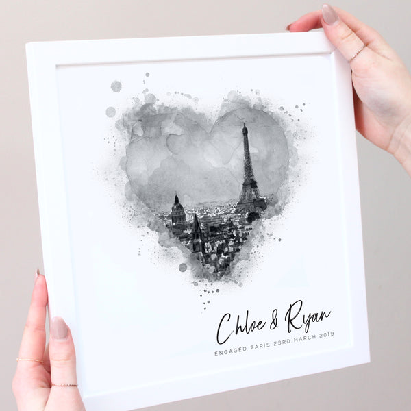 black and white illustration of eiffel tower in white frame with hands