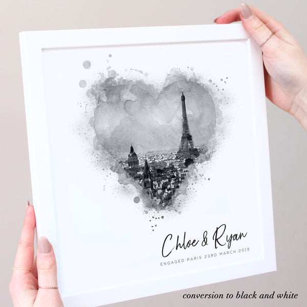 black and white illustration of Paris in white frame with hands