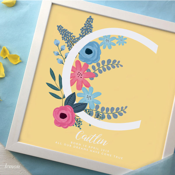 New Baby gift with large letter C and dainty flowers in a white frame