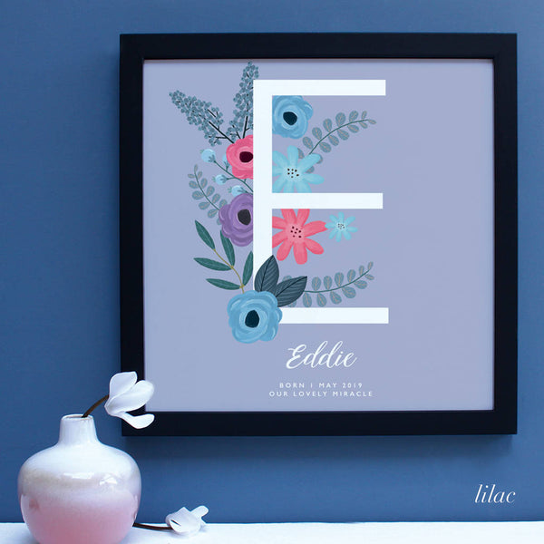 Black frame with large letter E with floral deco for New Baby Gift.