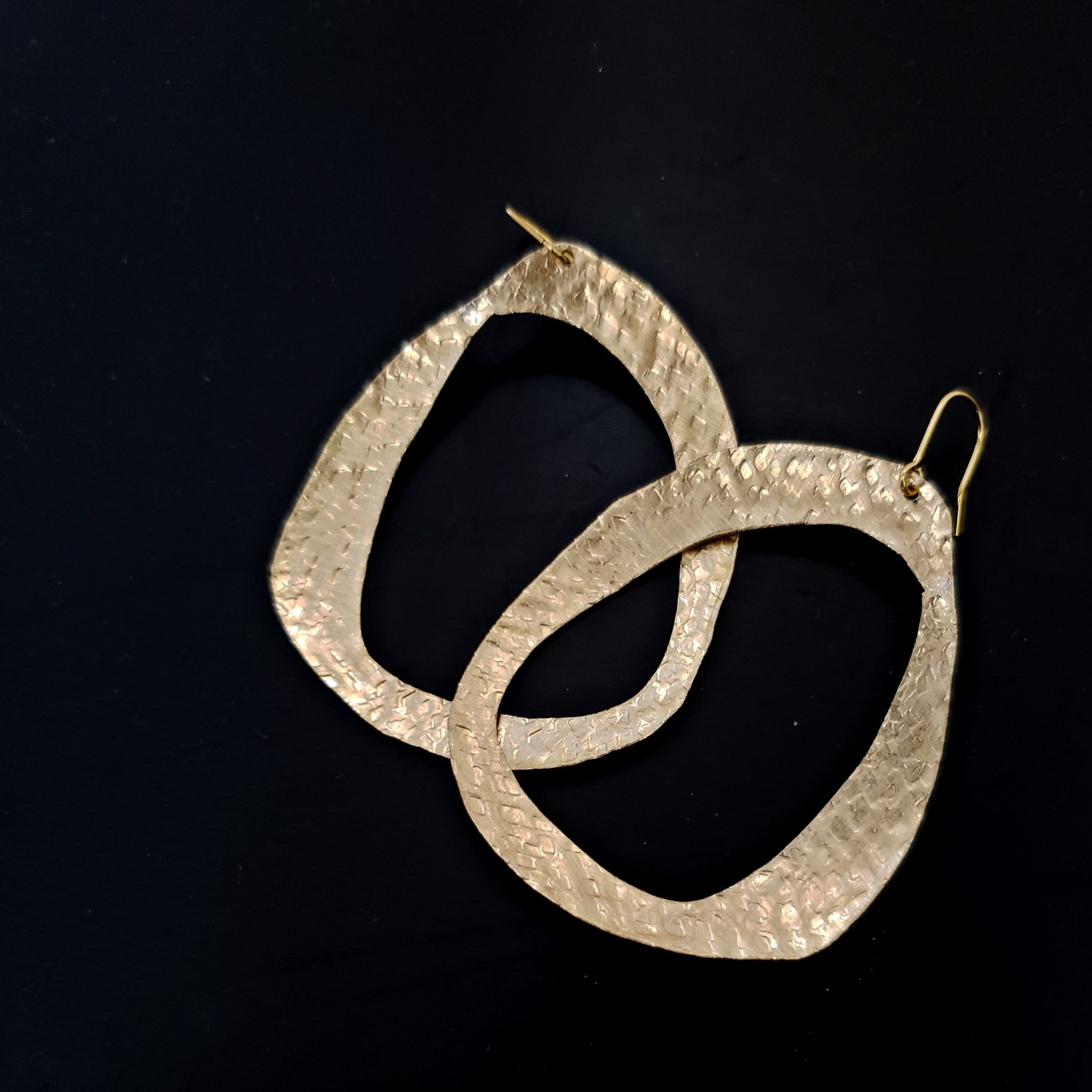 brass asymmetric circle earrings