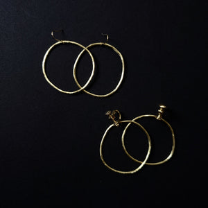 brass hand curved circle earrings