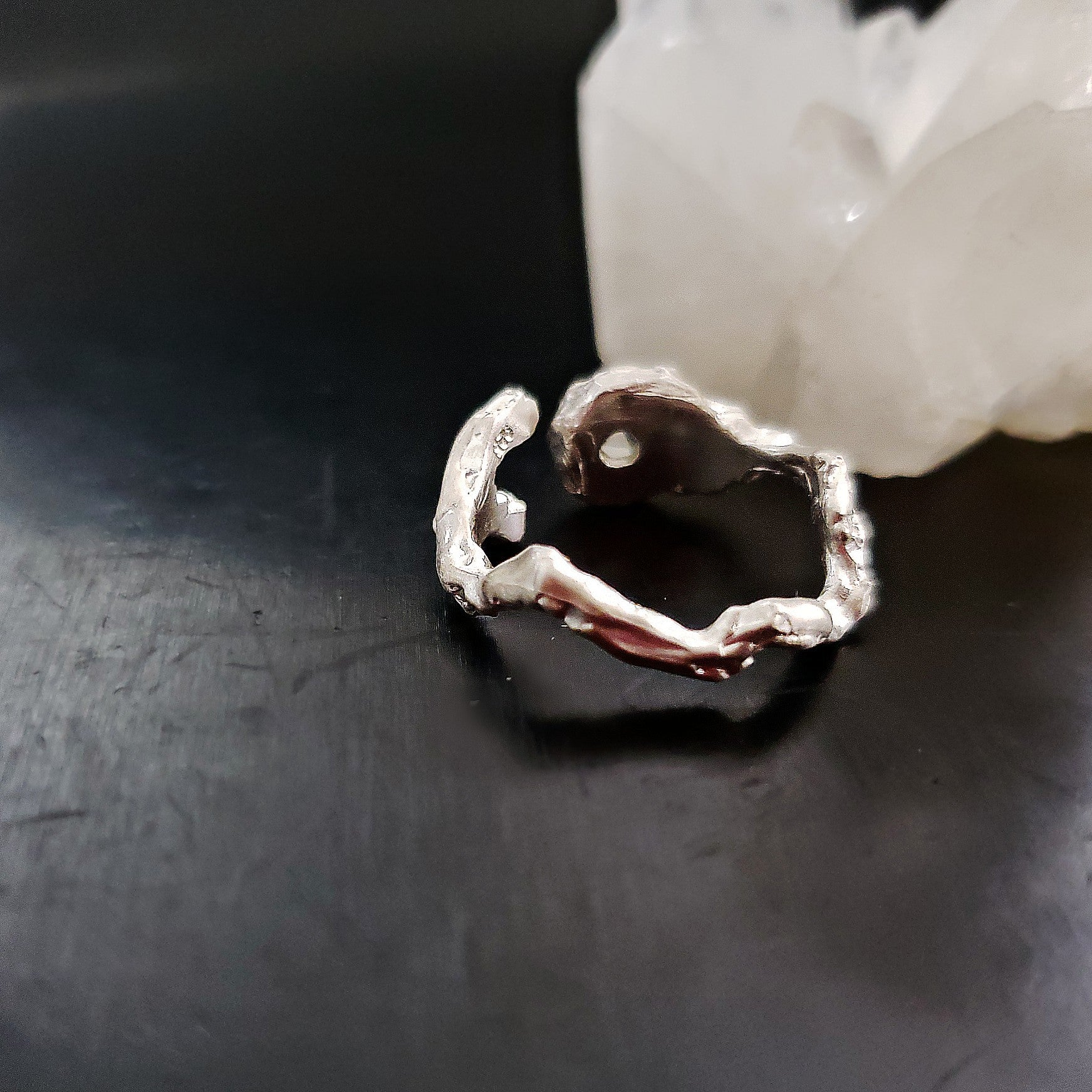 White topaz and black diamond curved ring