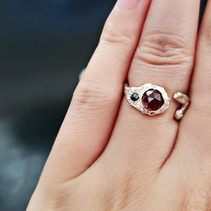 Red garnet and black diamond curved ring