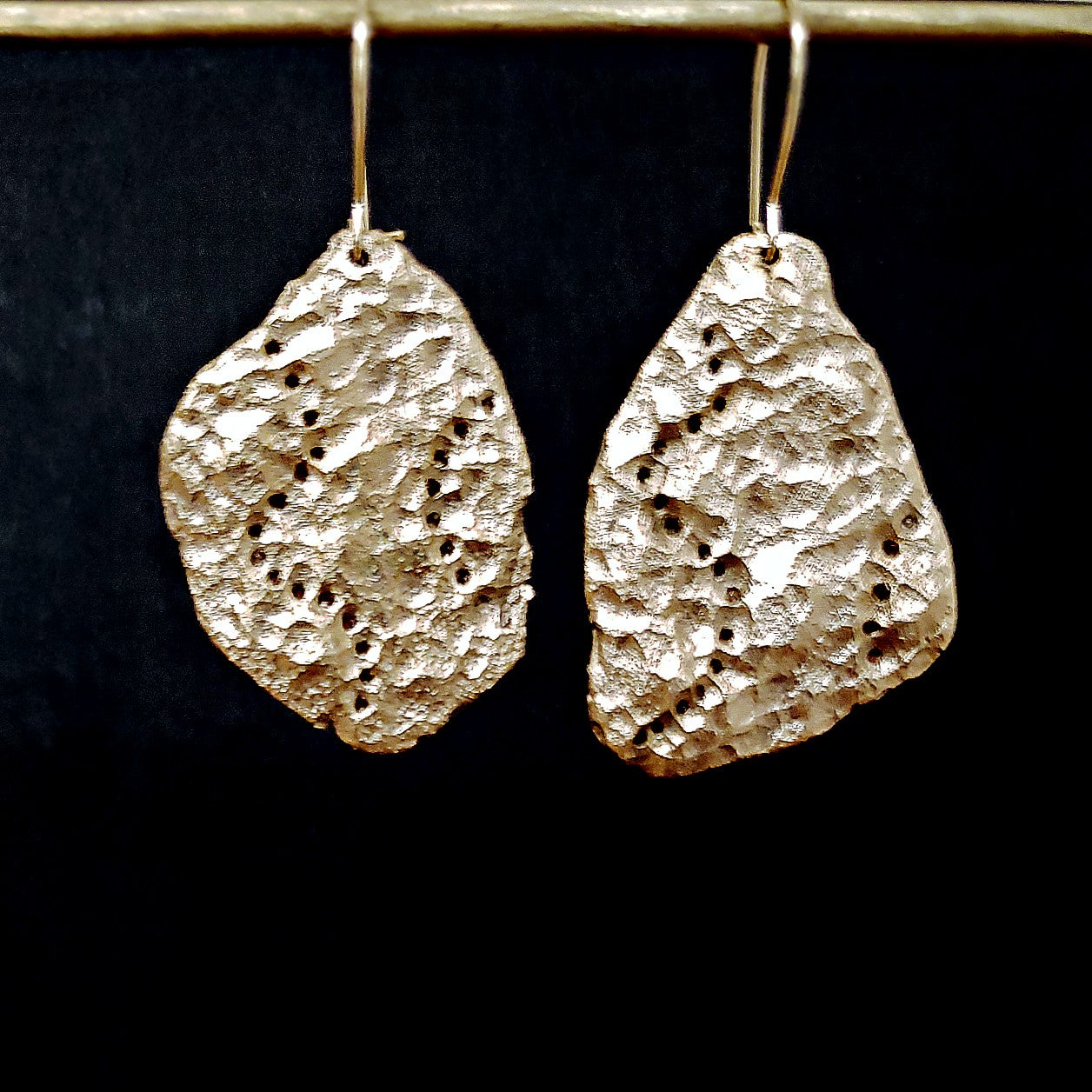 Asymmetric erosion earrings